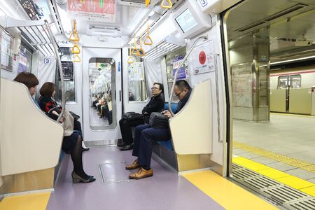 TOKYO, JAPAN - NOVEMBER 30, 2016: People ride a metro train in Tokyo. With more than 3.1 billion annual passenger rides, Tokyo subway system is the busiest worldwide.