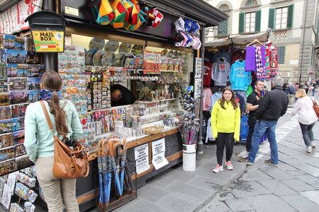 FLORENCE, ITALY - APRIL 30, 2015: People visit gift shop in Florence, Italy. Italy is visited by 47.7 million tourists a year (2013).