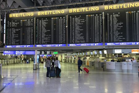 FRANKFURT, GERMANY - DECEMBER 6, 2016: Passengers visit Terminal 1 of Frankfurt International Airport in Germany. It is the 12th busiest airport in the world with 61 million passengers in 2015.