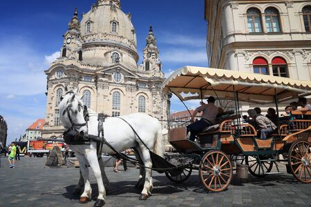 DRESDEN, GERMANY - MAY 10, 2018: Horse carriage ride at Neumarkt square in Altstadt (Old Town) district of Dresden, the 12th biggest city in Germany. Editorial