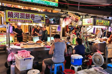 TAIPEI, TAIWAN - DECEMBER 4, 2018: Popiah spring roll vendor at Raohe Night Market in Taipei. Popiah is typical for Fujianese and Teochew-style cuisine.