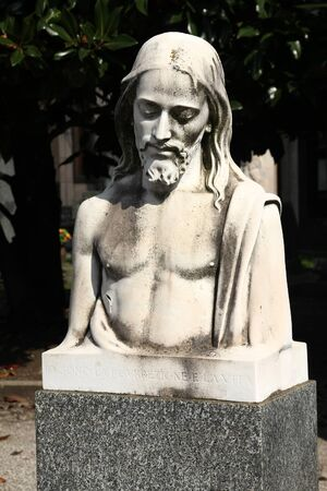 MILAN, ITALY - OCTOBER 6, 2010: Jesus Christ monument at Cimitero Monumentale in Milan. The Monumental Cemetery designed by the architect Carlo Maciachini is famous for its elaborate style.