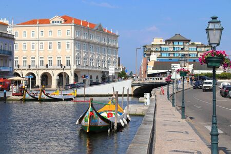 AVEIRO, PORTUGAL - MAY 23, 2018: Aveiro canal gondola-style boats in Portugal. Aveiro is known as the Venice of Portugal because of its canals. Éditoriale