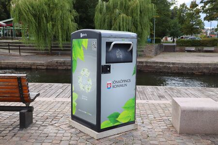 JONKOPING, SWEDEN - AUGUST 25, 2018: BigBelly trash compacting public space bin in Jonkoping Sweden.