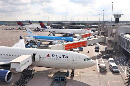 AMSTERDAM, NETHERLANDS - JULY 11, 2017: Airlines at Schiphol Airport in Amsterdam. Schiphol is the 12th busiest airport in the world with more than 63 million annual passengers.
