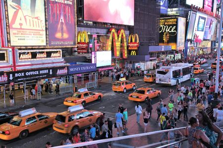 NEW YORK, USA - JULY 1, 2013: People visit Times Square in New York. The square at junction of Broadway and 7th Avenue has some 39 million visitors anually.