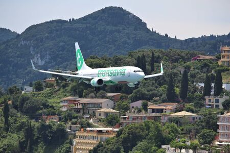 CORFU, GREECE - JUNE 5, 2016: Transavia Boeing 737-800 arrives at Corfu International Airport, Greece. Transavia is a Dutch low-cost airline owned by KLM. Editorial