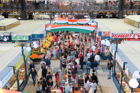BUDAPEST, HUNGARY - JUNE 19, 2014: People visit Great Market Hall in Budapest. Opened in 1897, it remains the largest and oldest indoor market in Budapest.