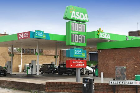 LONDON, UK - JULY 9, 2016: Petrol prices at Asda gas station in London. Asda operates more than 300 petrol stations in the UK. Asda is part of Walmart group. Editorial