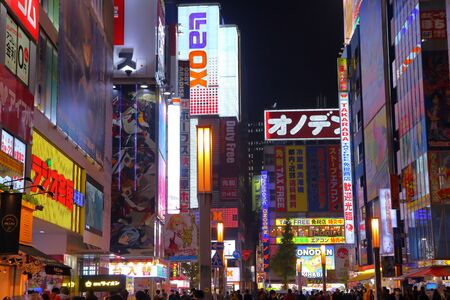 TOKYO, JAPAN - DECEMBER 1, 2016: Night street view of Akihabara district of Tokyo, Japan. Akihabara district is known as Electric Town district, it has reputation for electronics stores and otaku culture.