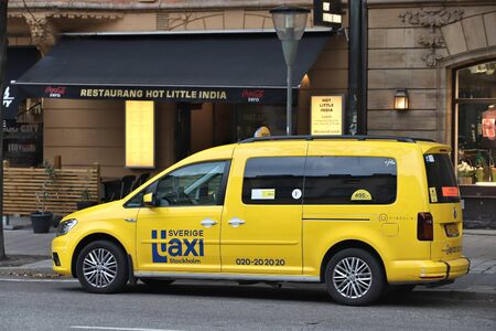 STOCKHOLM, SWEDEN - AUGUST 22, 2018: Yellow taxi cab in Stockholm. Taxi service market in Sweden is relatively liberal. Editöryel