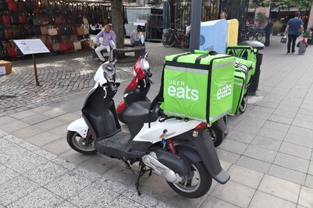 STOCKHOLM, SWEDEN - AUGUST 23, 2018: Uber Eats food delivery motorcycle in Stockholm, Sweden. This food delivery service is part of Uber ride sharing company.