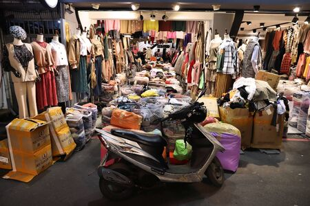 TAIPEI, TAIWAN - DECEMBER 4, 2018: Wufenpu fashion wholesale shopping market in Taipei. There are more than 1,000 clothes shops in the area.