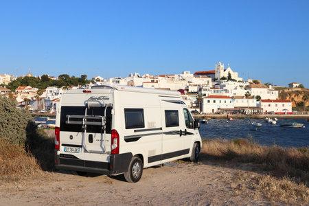 FERRAGUDO, PORTUGAL - JUNE 2, 2018: Camper van (RV) parked in Ferragudo. Coastal region of Algarve attracts more than 17 million tourists annually. Redakční