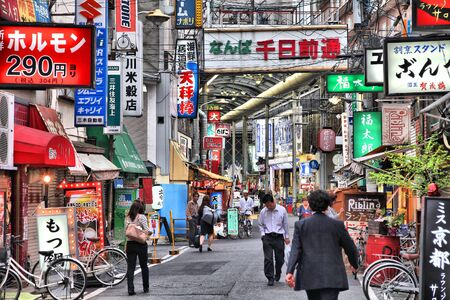 OSAKA, JAPAN - APRIL 25, 2012: Evening street view in Namba district, Osaka, Japan. Osaka is Japans 3rd largest city by population with 18 million people in its urban area.