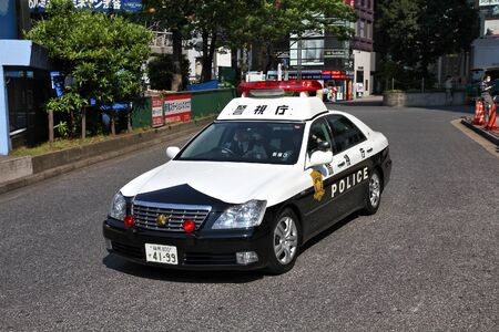 TOKYO, JAPAN - MAY 11, 2012: Police car Toyota Crown in Shibuya Ward, Tokyo. There are some 289,000 police officers in Japan.