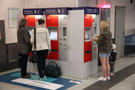 NUREMBERG, GERMANY - MAY 6, 2018: People buy train tickets in a machine at Nuremberg Central Station, Germany. Nuremberg is located in Middle Franconia. 511,628 people live here.