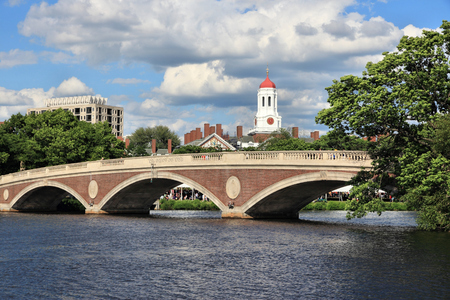 Cambridge, Massachusetts. Harvard University campus with Charles River bridge. Фото со стока