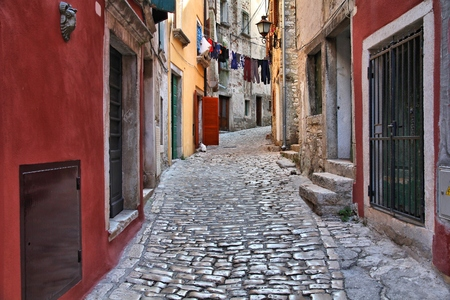 Croatia - Rovinj on Istria peninsula. Old town stone paved street.