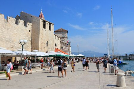 TROGIR, CROATIA - SEPTEMBER 11, 2012: Tourists visit Old Town in Trogir, Croatia. Trogir, as a UNESCO World Heritage Site, is one of most visited places in Croatia.