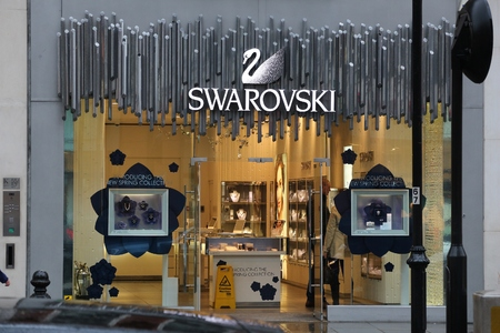 LONDON, UK - APRIL 22, 2016: Swarovski jewelry store in London, UK. Annual retail sales in the UK amounted to 421 billion GBP in 2018.