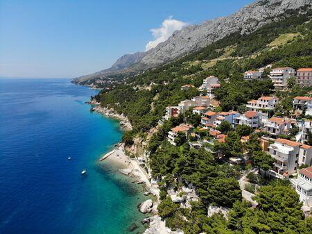 Dalmatia drone view - Croatia aerial landscape photo. Marusici and Mimice town with Biokovo mountains.