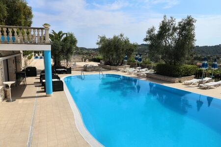 GARGANO, ITALY - JUNE 6, 2017: Generic hotel pool at Gargano Peninsula. Italy is one of most visited countries in the world with 50.7 million arrivals in 2015.