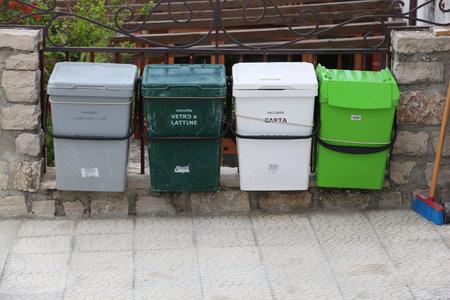 GARGANO, ITALY - JUNE 6, 2017: City waste sorting bins in Gargano Peninsula, Italy.