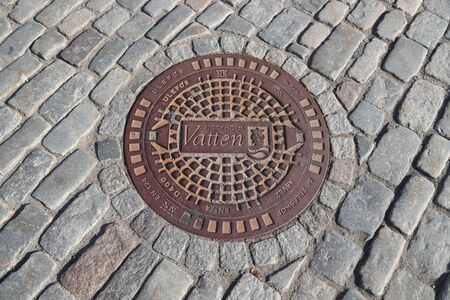 STOCKHOLM, SWEDEN - AUGUST 24, 2018: Stockholm Vatten manhole cover. Stockholm is the capital city and most populous area in Sweden.
