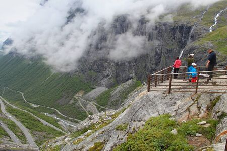 TROLLSTIGEN, NORWAY - JULY 20, 2015: People visit a viewpoint at Trollstigveien, Norway. Foreign tourists spent some 5 million overnight stays in Norway in 2013. Éditoriale