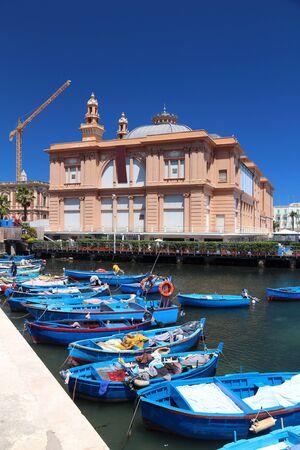 Bari Margherita Theater and fishing boats - harbor in Apulia region, Italy.