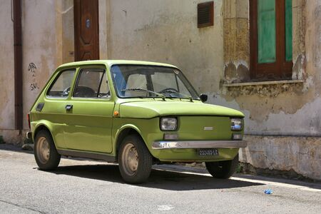 NARDO, ITALY - MAY 30, 2017: Fiat 126 classic oldtimer small car in Nardo, Italy. There are 41 million motor vehicles registered in Italy.