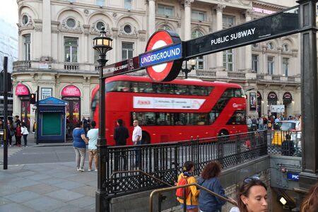 LONDON, UK - JULY 14, 2019: Passengers enter London Underground station at Piccadilly Circus. London Underground is the 11th busiest metro system worldwide with 1.1 billion annual rides. Redactioneel