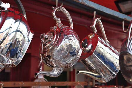 Antique engraved steel teapot at Portobello Road Market in Notting Hill, London.