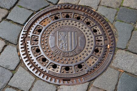 DRESDEN, GERMANY - MAY 10, 2018: Manhole cover for sewers of Dresden, the 12th biggest city in Germany.