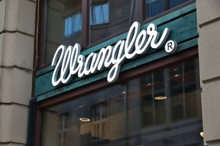 LEIPZIG, GERMANY - MAY 9, 2018: Wrangler store sign in Leipzig, Germany. Wrangler is an American brand of jeans owned by Kontoor Brands.