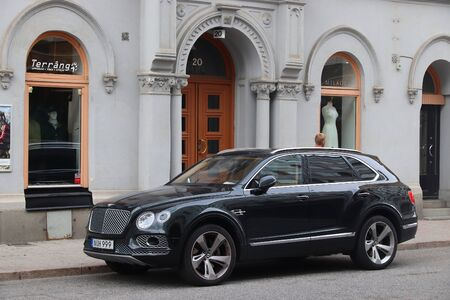 STOCKHOLM, SWEDEN - AUGUST 24, 2018: Bentley Bentayga luxury crossover SUV parked in Stockholm, Sweden. There are 4.8 million passenger cars registered in Sweden. Editorial