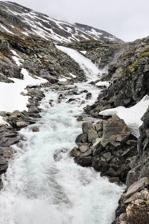 Norway landscape in mountain valley - Strynefjellet. Mountain stream.