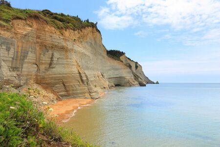 Corfu beach landscape - island in Greece. Logas Beach below the cliffs. Stok Fotoğraf