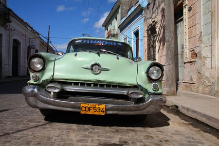CAMAGUEY, CUBA - FEBRUARY 17, 2011: Vintage car parked in Camaguey, Cuba. Cuba has one of the lowest car-per-capita rates (42 per 1000 people in 2015).