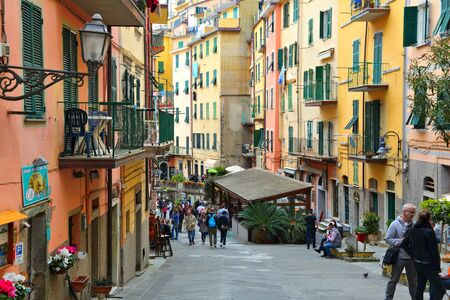 RIOMAGGIORE, ITALY - APRIL 26, 2015: People visit Riomaggiore in Italy. It is part of Cinque Terre, a UNESCO World Heritage site established in 1997. Editorial
