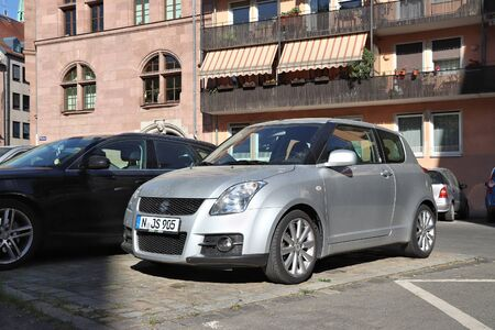 NUREMBERG, GERMANY - MAY 6, 2018: Silver Suzuki Swift compact hatchback car parked in Germany. There were 45.8 million cars registered in Germany (as of 2017).