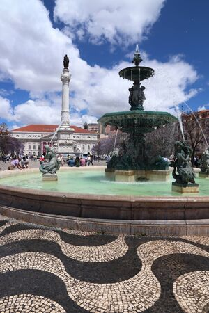 LISBON, PORTUGAL - JUNE 5, 2018: People visit Rossio Square in Lisbon, Portugal. Lisbon is the 11th-most populous urban area in the EU (2.8 million people).