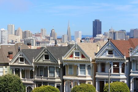 San Francisco skyline with Alamo Square in foreground.