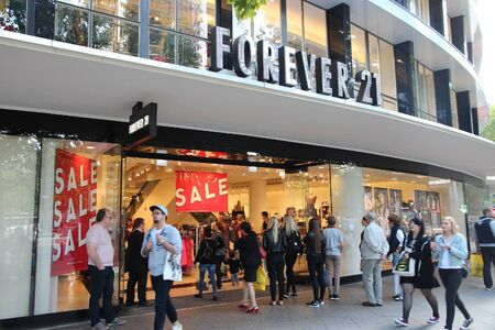 BERLIN, GERMANY - AUGUST 27, 2014: People visit Forever 21 fashion store at Tauentzienstrasse in Berlin. There are more than 700 Forever 21 stores worldwide (2015).