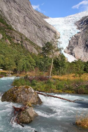 Norway nature, Jostedalsbreen National Park. River originating from Briksdalsbreen glacier in Briksdalen valley.