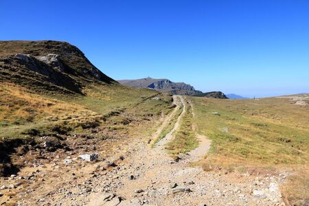 Nature in Romania - mountain trail view in Bucegi Mountains (part of Carpathians). Hiking trails of Romania. Stock Photo