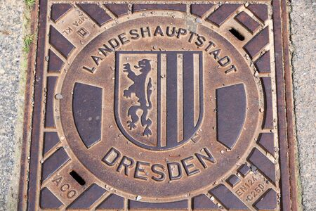 DRESDEN, GERMANY - MAY 10, 2018: Manhole cover (Kanaldeckel) for sewers of Dresden, the 12th biggest city in Germany.