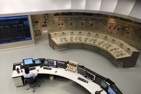 ITAIPU, BRAZIL - OCTOBER 11, 2014: Staff works at Itaipu Binacional Power Plant control room. The famous hydro power plant is located on Paraguay-Brazil border and is shared between two countries. Editorial