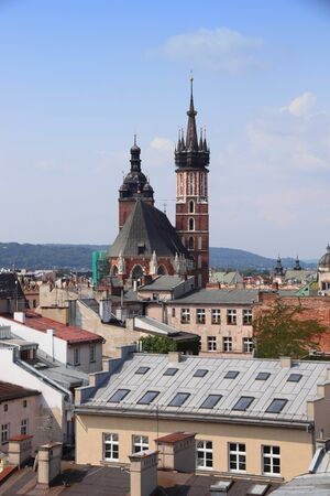 Krakow city in Poland. Cityscape with rooftops and St. Marys Basilica. 版權商用圖片